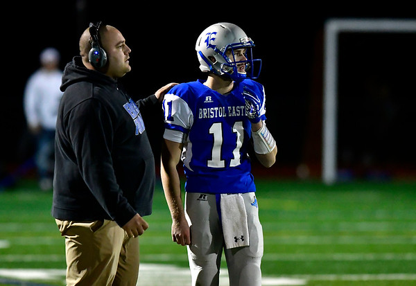 10/19/2018 Mike Orazzi | Staff Bristol Eastern High School Head Football Coach Anthony Julius and Justin Marshall (11) during Friday night's football game with Platt at BEHS in Bristol.