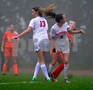 10/2/2018 Mike Orazzi | Staff Wamogo's Cassidy Wilson (13) and Alexis Weik (5) and  Terryville High School's Zoe Zappone (14) Tuesday afternoon.
