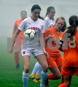 10/2/2018 Mike Orazzi | Staff Wamogo's Cassidy Wilson (13) and Terryville's Zoe Zappone (14) during girls soccer Tuesday afternoon.