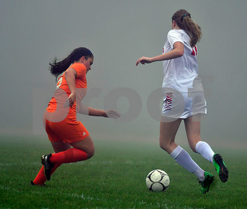 10/2/2018 Mike Orazzi | Staff Wamogo's Cassidy Wilson (13) and Terryville High School's Kelly Poulin (6) Tuesday afternoon during girls soccer.