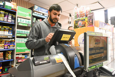 10/22/18  Wesley Bunnell | Staff  Co owner of Wiley's Convenience and Deli on West Main St in New Britain Gokul Shah works the lottery machine on Monday afternoon.