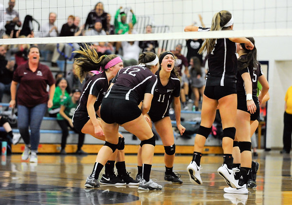 10/22/18 Wesley Bunnell | Staff Bristol Eastern defeated Bristol Central on Monday night 3-1. Gwen Toresso (11) and teammates celebrate a point.