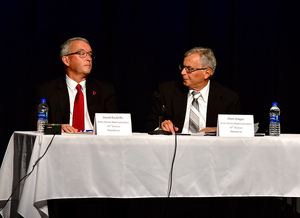 10/23/2018 Mike Orazzi | Staff David Rackliffe and Chris Ziogas during The Bristol Chamber of Commerce's Senate and House forum at St. Paul Catholic High School Tuesday night.