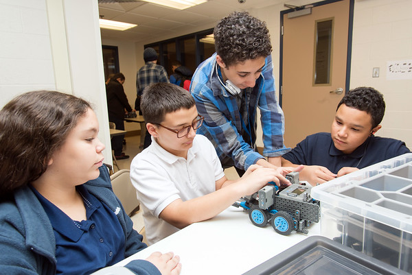 10/23/18 Wesley Bunnell | Staff Bristol Boys and Girls Club employee Josias Reynoso, standing, helps members of the New Britain Boys and Girls Club, Yaneliz Vazquez, L age 11, Logan Roy, age 12, and Adrian Torres, age 12, during a robotics class on Tuesday evening at the New Britain club location.