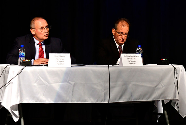 10/23/2018 Mike Orazzi | Staff Henri Martin and Christopher Wright during The Bristol Chamber of Commerce's Senate and House forum at St. Paul Catholic High School Tuesday night.