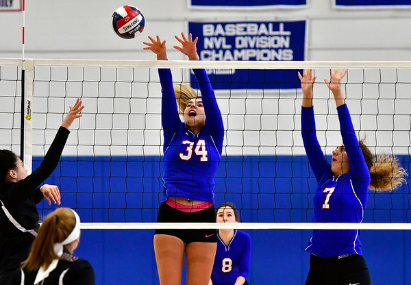 10/24/2018 Mike Orazzi | Staff St. Paul's Morgan Kolb (34) and Rebecca Nerbonne (7) during volleyball Wednesday with Innovation in Bristol.