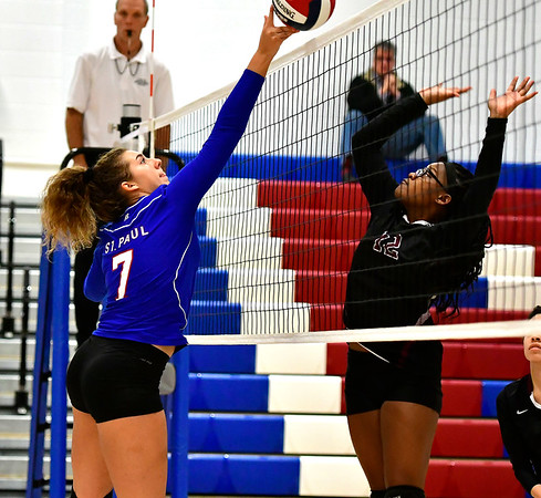 10/24/2018 Mike Orazzi | Staff St. Paul's Rebecca Nerbonne (7) and Innovation's Tamia Walker (12) during girls volleyball in Bristol Wednesday night.