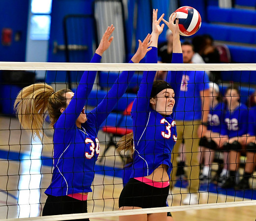 10/24/2018 Mike Orazzi | Staff St. Paul's Morgan Kolb (34) and Kelsi Blatchley (34) during volleyball Wednesday with Innovation in Bristol.