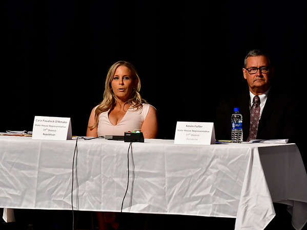 10/23/2018 Mike Orazzi | Staff Cara Pavalock-D'Amato and Kevin Fuller during The Bristol Chamber of Commerce's Senate and House forum at St. Paul Catholic High School Tuesday night.