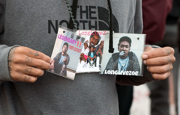 10/24/18 Wesley Bunnell | Staff A rally was held at Central Park on Wednesday evening calling for the release of police video from the December 14 2017 New Britain Police shooting which resulted in the death of Zoe Dowdell of Bloomfield. Step brother Hakeem Robinson holds up photos of Zoe.