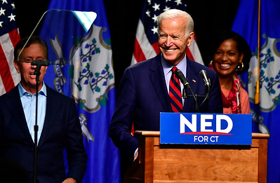 10/26/2018 Mike Orazzi | Staff  Ned Lamont and Connecticut 5th congressional district candidate Jahana Hayes with former Vice President Joe Biden in Hartford on Friday.