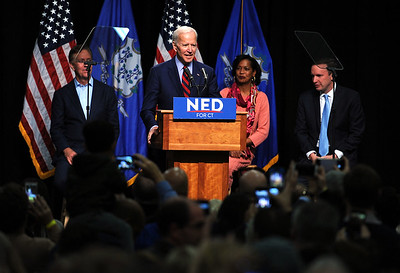 10/26/2018 Mike Orazzi | Staff  Ned Lamont and Connecticut 5th congressional district candidate Jahana Hayes and Chris Murphy on stage with former Vice President Joe Biden in Hartford on Friday.