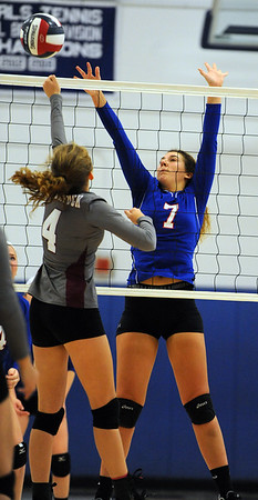 10/27/2018 Mike Orazzi | Staff Naugatuck's Hailey Russell (4) and St. Paul's Rebecca Nerbonne (7) in Bristol Saturday.
