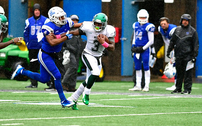 10/27/2018 Mike Orazzi | Staff CCSU's Tymir Hinton (4) and Wagner's Ryan Fulse (3) during Saturday's football game in New Britain with CCSU.