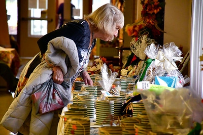 10/27/2018 Mike Orazzi | Staff Phyllis Whyte (is correct) looks over items in the silent auction during the Bristol Senior Center's annual craft fair on Saturday in Bristol.