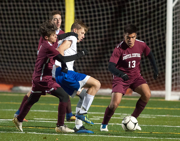 10/29/18 Wesley Bunnell | Staff Bristol Central boys soccer vs Bristol Eastern on Monday night in a game played at Bristol Central High School. Eastern's Jacob Woznicki (10) battling Central defenders.