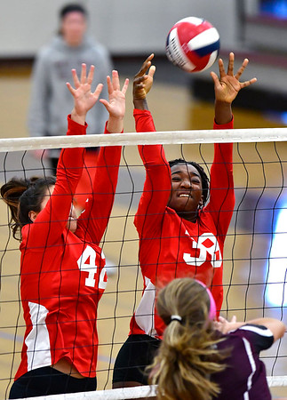 10/30/2018 Mike Orazzi | Staff Conard's Alexandra Buyak (42) and Fely YigleKaljob (38) during the CCC volleyball tournament at Central on Tuesday.