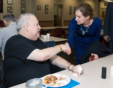 10/30/18  Wesley Bunnell | Staff  Democratic candidate for Lt. Governor Susan Bysiewicz shakes hands with Edward Suchecki at the New Britain Senior Center during a visit by Democratic candidates for state office.