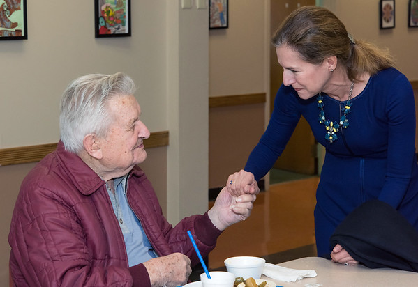 10/30/18 Wesley Bunnell | Staff Democratic candidate for Lt. Governor Susan Bysiewicz holds hands with Joe Smyk at the New Britain Senior Center during a visit by Democratic candidates for state office.