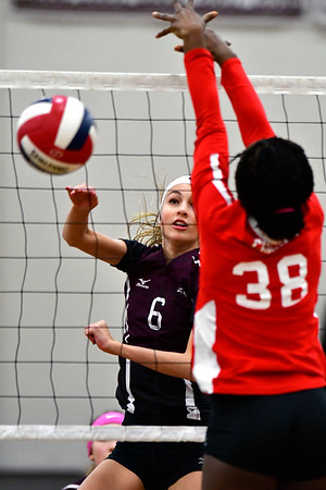 10/30/2018 Mike Orazzi | Staff Bristol Central's Emily Ericson (6) and Conard's Fely YigleKaljob (38) during the CCC volleyball tournament at Central on Tuesday.