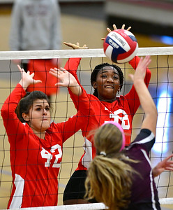 10/30/2018 Mike Orazzi | Staff Conard's Alexandra Buyak (42) and Fely Yigle­Kaljob (38) during the CCC volleyball tournament at Central on Tuesday.
