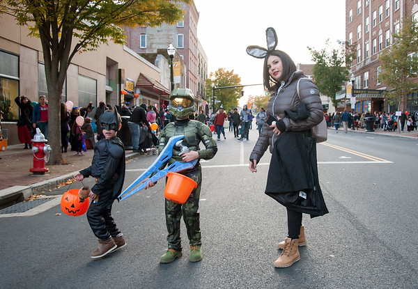 10/31/18 Wesley Bunnell | Staff Yabdel Rodriguez, L, Dhammat Rodriguez and their mother Tatiana Perez walk down a closed off West Main St near Central Park during New Britain's Halloween Safe Zone event on Halloween night.