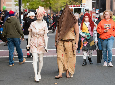 10/31/18  Wesley Bunnell | Staff  Connie Lynch dressed as The Nurse and Zylund Lynch as Pyramid Head from Silent Hill walk down West Main St on Halloween during New Britain's Halloween Safe Zone event.