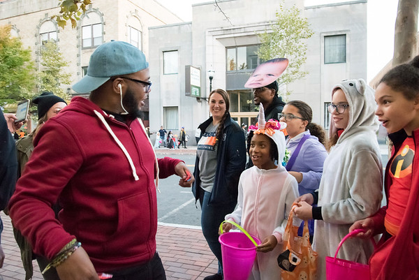 10/31/18 Wesley Bunnell | Staff Miciah Clark co-owner of So So Fly Clothing Store on West Main St stands outside of his store as he passes out candy to Jadian Palmer, age 9, Elayna Clark, age 11, Sadie Clark, age 13, and Jillian Black, age 10 during New Britain's Halloween Safe Zone event on Halloween.