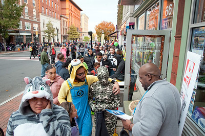 10/31/18  Wesley Bunnell | Staff  Duane Pierre from Channel Xiro Media speaks to children and their parents while passing out candy on West Main St during New Britain's Halloween Safe Zone event on Halloween.