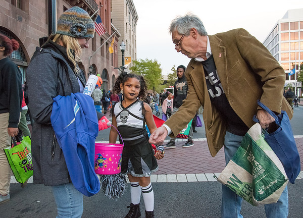 10/31/18 Wesley Bunnell | Staff State Rep. Peter Tercyak passes out candy to Jayleen Pare, age 6, and her mom Danielle Pare during New Britain's Halloween Safe Zone Event at Central Park.
