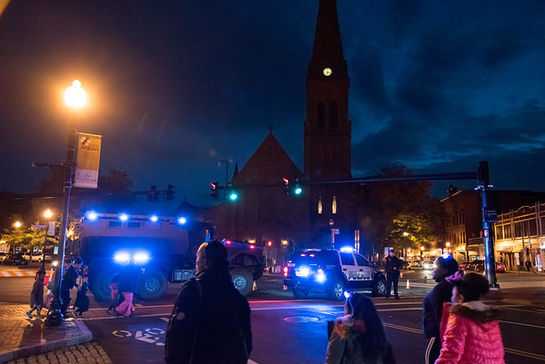 10/31/18 Wesley Bunnell | Staff Trick-or-treaters walk down Main St near Chestnut with South Church visible in the background as they leave New Britain's annual Halloween Safe Zone event on Halloween night.