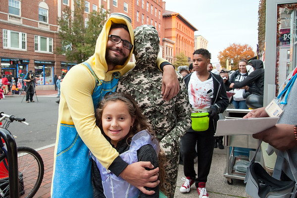 10/31/18 Wesley Bunnell | Staff Miguel Villanueva, L, hugs daughter Eriana Lozada, age 7 and Jonuel Valle on West Main St on Halloween night during New Britain's Halloween Safe Zone event.