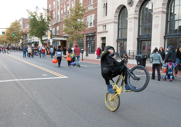 10/31/18 Wesley Bunnell | Staff A bicyclist rides his bike down a closed off West Main St in front of New Britain City Hall during New Britain's Halloween Safe Zone event on Halloween night.