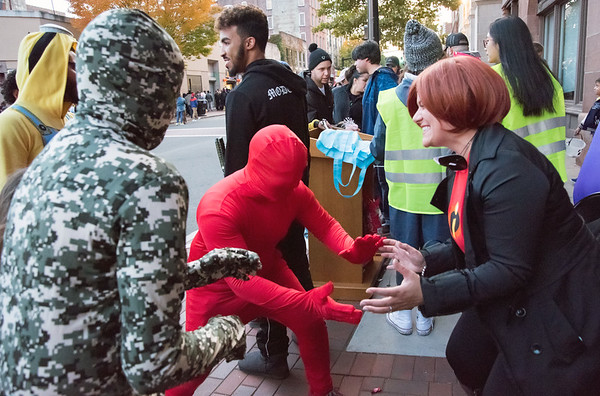 10/31/18 Wesley Bunnell | Staff Mayor Erin Stewart, R, grabs an imaginary box from trick or treaters during New Britain's annual Halloween Safe Zone Event on Wednesday night.