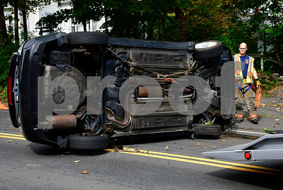 10/4/2018 Mike Orazzi | Staff The scene of a one vehicle rollover crash on Mix Street near the intersection with Jerome Thursday morning. The single occupant was able to extricate himself and was uninjured.