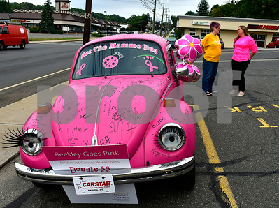 10/4/2018 Mike Orazzi | Staff Cindy Guendert talks with Heather Dell'Aera in front of a 1971 pink Volkswagen Beetle as part of a Bristol Hospital fundraiser for Beekley Center in front of the Harvest Bakery on Route 6 Thursday.