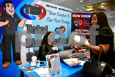10/4/2018 Mike Orazzi | Staff Total Mechanical Systems' Traci Wood talks with Karen Lee-Torres during The Central Connecticut Chambers of Commerce's Manufacturing and Trades Job Fair  at the DoubleTree by Hilton hotel in Bristol Friday morning.