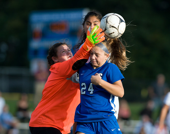 10/09/18 Wesley Bunnell | Staff Southington girls soccer defeated Platt at home on Tuesday afternoon. Talie Richardson (24) gets tangled with goalkeeper Martha Chatman (1).