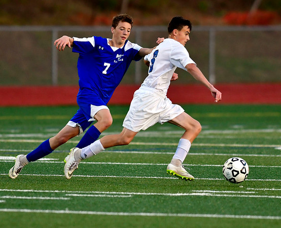 10/9/2018 Mike Orazzi | Staff Bristol Eastern's Elijah Parent (7) and Southington's Andrew Kudla (6) at BEHS Tuesday.