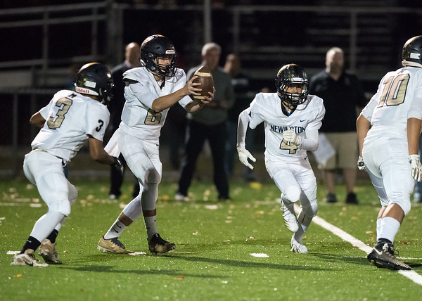11/01/18 Wesley Bunnell   Staff Newington football vs Maloney at Falcon Field in Meriden on Thursday evening. QB Nicholas Pestrichello (6) hands off to Dylan Nees-Fair (3) as Izayah Ciarcia (4) is in motion.