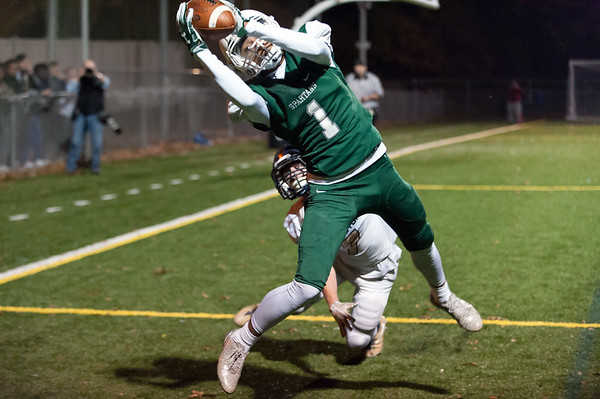 11/01/18 Wesley Bunnell   Staff Newington football vs Maloney at Falcon Field in Meriden on Thursday evening. Maloney receiver Graham Larue (1) with a touchdown reception late in the 2nd quarter.