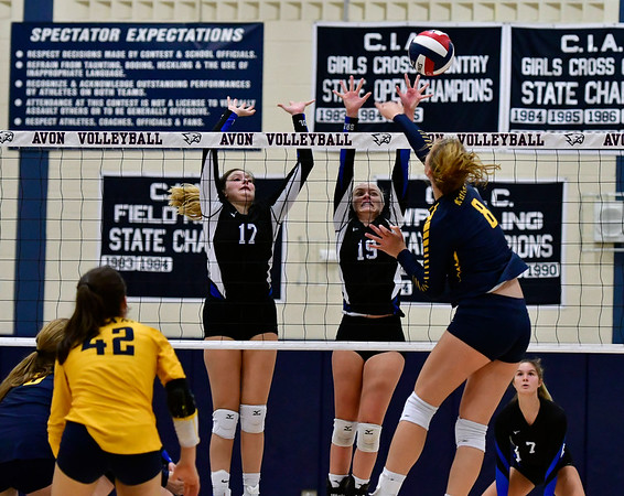 11/1/2018 Mike Orazzi   Staff Bristol Eastern's Gabriella Nozzolillo (17) and Amber Blais (19) at the net with RHAM's Kaylin Hadley (8) during the CCC Volleyball Tournament at Avon High School Thursday night.