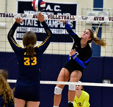 11/1/2018 Mike Orazzi   Staff Bristol Eastern's Zoe Lowe (7) with RHAM's Zoe Parkinson (33) during the CCC Volleyball Tournament at Avon High School Thursday night.
