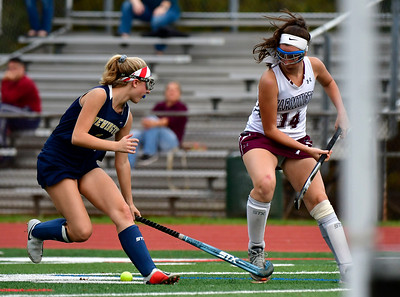 11/1/2018 Mike Orazzi | Staff Farmington's Johanna Wolkoff (14) and Newington's Samantha Giudice (1)  during field hockey at Farmington High School Thursday.