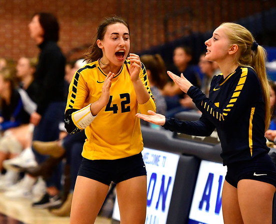 11/1/2018 Mike Orazzi   Staff RHAM's Meredith Blinn (42) and Lexi Massey (3) during the CCC Volleyball Tournament at Avon High School Thursday night.