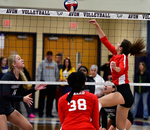 11/1/2018 Mike Orazzi   Staff Farmington High Schools Maya Lipinski (11) and Conards Fely Yigle-Kaljob (38) and Cate Di Giacomo (8) during the CCC Volleyball Tournament held at Avon High School Thursday night.
