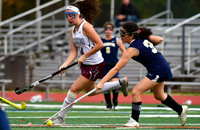 11/1/2018 Mike Orazzi | Staff Farmington's Johanna Wolkoff (14) and Newington's Isabella Gugliott (3) during field hockey at Farmington High School Thursday.