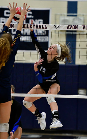 11/1/2018 Mike Orazzi   Staff Bristol Eastern's Amber Blais (19) at the net with RHAM's Kate Santella (2) during the CCC Volleyball Tournament at Avon High School Thursday night.