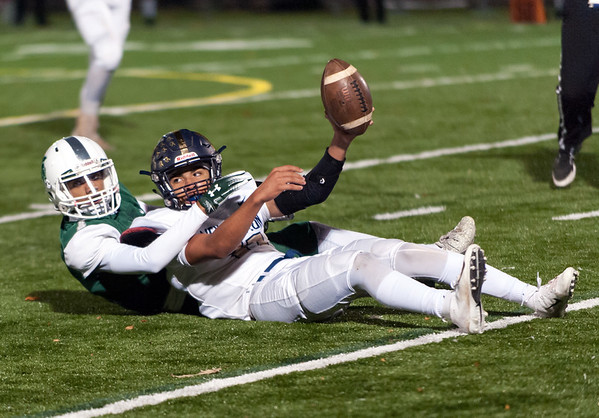 11/01/18 Wesley Bunnell   Staff Newington football vs Maloney at Falcon Field in Meriden on Thursday evening. Keenan Esau (11) holds the ball up for the official after making a catch.