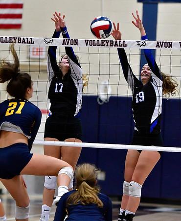11/1/2018 Mike Orazzi   Staff RHAM High School's Bella Johnson (21) and Bristol Eastern's Gabriella Nozzolillo (17) and Amber Blais (19) during the CCC Volleyball Tournament at Avon High School Thursday night.